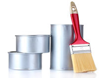 Closed tin cans with paint and brush Royalty Free Stock Photography