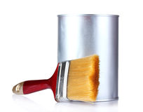 Closed tin cans with paint and brush Royalty Free Stock Photos
