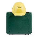 Closed tool box with construction yellow helmet Royalty Free Stock Photo