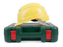 Closed tool box with construction yellow helmet Royalty Free Stock Photos
