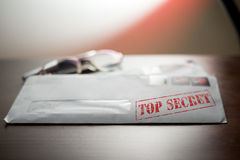 Closed top secret envelope on table Stock Images