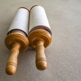 Torah scroll printed on parchment on a background of grey canvas. Closed Torah scroll on the canvas, the blurred background Royalty Free Stock Photo