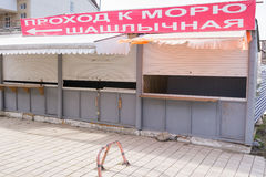 Closed trade pavilions with a banner, a passage to the sea and barbecue Stock Photography