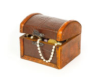 Closed treasure chest with bracelet, coins and pearls Royalty Free Stock Image