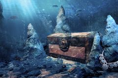 Closed treasure chest underwater royalty free stock photo