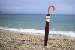 Closed  umbrella on the beach Royalty Free Stock Photo