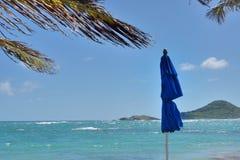 Closed umbrella by sea Royalty Free Stock Image