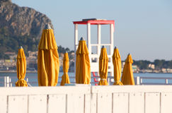 Closed umbrellas of a bathing establishment Royalty Free Stock Image