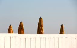 Closed umbrellas of a bathing establishment Stock Photo