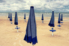 Closed umbrellas on the beach of the Baltic Sea Royalty Free Stock Image
