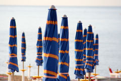 Closed umbrellas on the beach Royalty Free Stock Photo