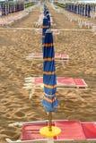 Closed umbrellas on the beach Royalty Free Stock Image
