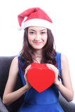 Closed up Asian woman with a christmas hat Stock Photos