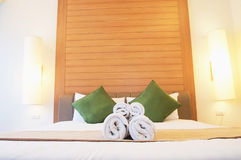 Closed up bed in luxury hotel room Royalty Free Stock Photos