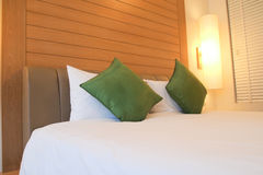 Closed up bed in luxury hotel room Stock Images