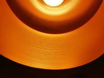Closed up of black orange ceiling lamp with energy saving fluorescent light bulb royalty free stock photos