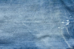 Closed up of blue creased denim jeans texture Royalty Free Stock Photography