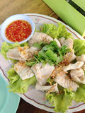 Closed up boiled fish with spicy sauce Stock Photo