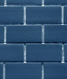 Closed up Bricks Wall in Indigo Blue Color, Vertical Image for Background. Texture, Pattern royalty free stock images