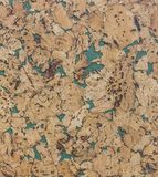 Closed up of brown cork board abstractpattern texture background with green royalty free stock photo