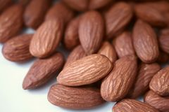 Closed up brown roasted almonds stock images