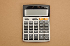 Closed-up calculator on brown background. For business or education royalty free stock photography