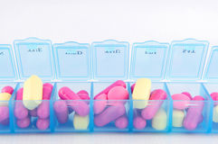Closed up capsule and tablets in daily pill box. Capsule and tablet in daily pill box  show medical concept Stock Photos