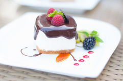 Closed up chocolate cake with berry Stock Photo