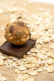 Closed up Chocolate peanut butter power ball among rolled oat fl. Akes for background stock photography