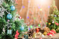 Closed up of Christmas tree with gift on old wood and light boke Stock Images