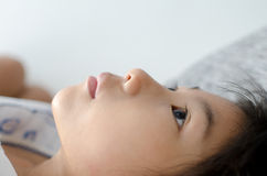 Closed up Cute Asian girl relaxing on bed Stock Images