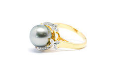 Closed up dark pearl with diamond and gold ring isolated Royalty Free Stock Image