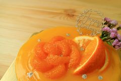 Closed Up Delectable Mandarin Orange Birthday Cake on the Wooden Table. Food texture stock photo