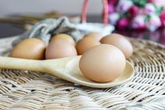 Closed up egg lay on wooden ladle Royalty Free Stock Images