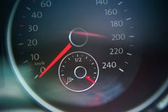Closed up of full petrol gauge with lens flare. Closed up of full petrol gauge, energy concept royalty free stock photography