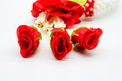 Closed up fabric red rose on Thai plastic garland isolated on wh. Ite background for buddhist respect Stock Photo