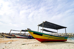 Closed up fisherman boat stranded on the sandy beach and cloudy sky royalty free stock photography