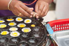 Closed up fried quail egg process. In Thailand Royalty Free Stock Image