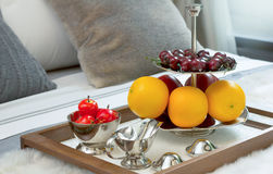Closed up fruits on wooden tray in bed Royalty Free Stock Photo