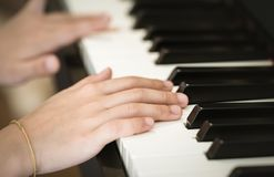 Closed up hand playing Music keyboard, side view. Closed up hand Hand playing Music piano keyboard, side view royalty free stock photography