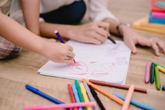 Closed up hands of mom teaching little children to drawing cartoon in art class with color pen. Back to school and Education. Concept. Family and Home sweet stock images