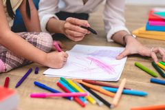 Closed up hands of mom teaching little children to drawing cartoon in art class with color pen. Back to school and Education. Concept. Family and Home sweet royalty free stock photos