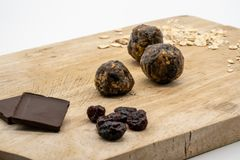 Closed up healthy energy ball and ingredients on wooden board ag. Ainst white background. Homemade no bake recipe royalty free stock photography