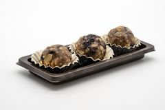 Closed up healthy energy ball in the plastic tray on white background. royalty free stock photography