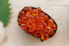 Closed up Ikura Salmon Roe  Sushi from Sushi Set on the Stone Plate. Stock Photo