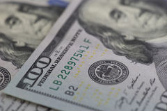 Closed-up image of 100 dollar banknotes. Selective focus techniq Stock Photo