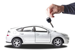 Closed up image of hand car mechanic giving car keys to client a Stock Photography