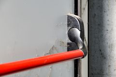 Closed up latch and door handle of emergency exit. Push bar and rail for panic exit. Closed up latch and door handle of emergency exit. Push bar and rail for royalty free stock photos