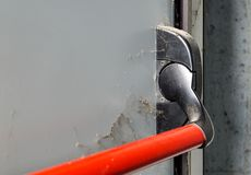 Closed up latch and door handle of emergency exit. Push bar and rail for panic exit. Closed up latch and door handle of emergency exit. Push bar and rail for royalty free stock image