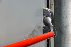 Closed up latch and door handle of emergency exit. Push bar and rail for panic exit. Closed up latch and door handle of emergency exit. Push bar and rail for stock image